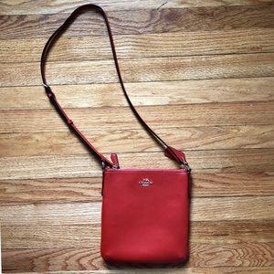 Burnt orange Coach purse